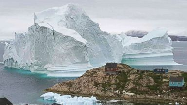 A massive iceberg threatening Greenland village has moved away from the coast
