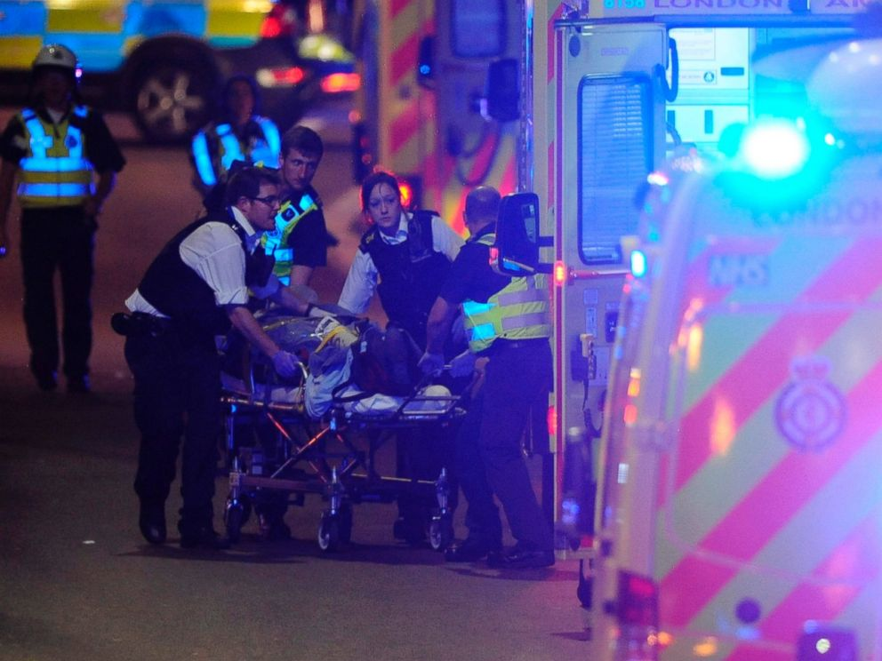 PHOTO: Police officers and members of the emergency services attend to a person injured in an incident on London Bridge in central London on June 3, 2017.