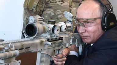 Vladimir Putin poses with new Kalashnikov sniper rifle