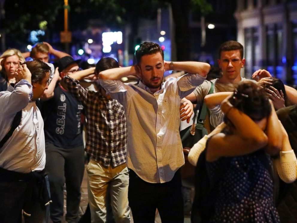 PHOTO: People leave the area with their hands up after an incident near London Bridge in London, June 4, 2017.