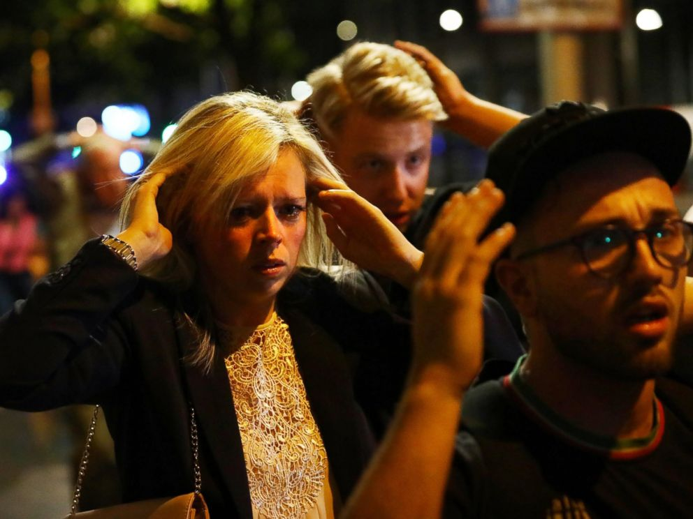 PHOTO: People leave the area with their hands up after an incident near London Bridge in London, Britain June 4, 2017.