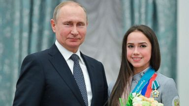 Putin honors Russian Olympic medalists, as IOC lifts doping ban