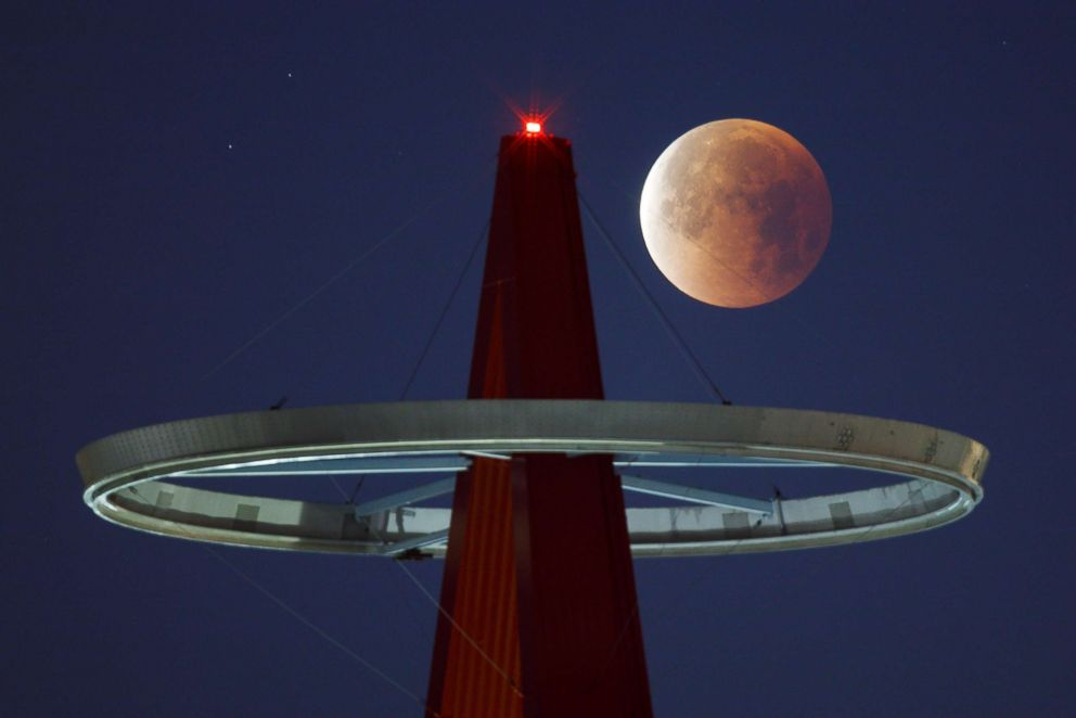PHOTO: A super moon shines its blood red colors during a full eclipse above the Big A Sign of Angel Stadium in Anaheim, Calif., on Jan., 31, 2018.