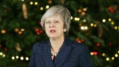 Theresa May continues Brexit talks in Brussels after surviving bid to topple her