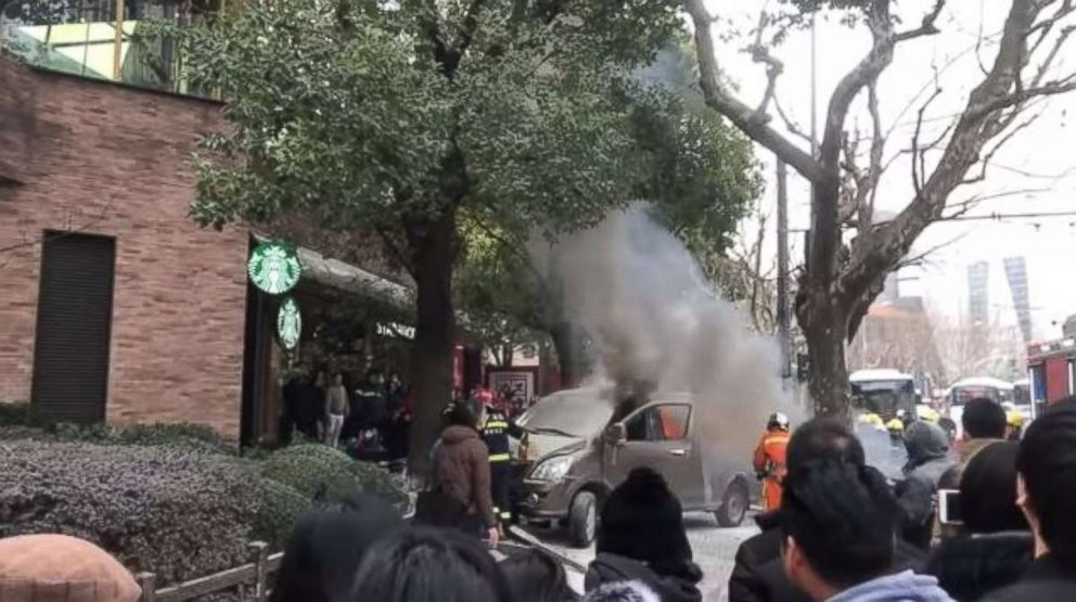 A van injured 17 people when it crashed into a fence outside a Starbucks in Shanghai, China, on Feb. 2, 2018.