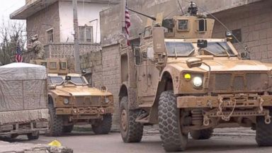 Why are US troops in the Syrian city of Manbij?
