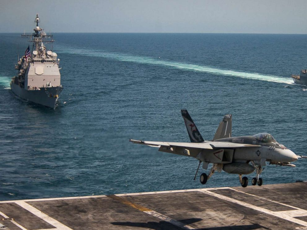 PHOTO: An F/A-18E Super Hornet lands on the flight deck of the USS Carl Vinson and the USS Lake Champlain (CG 57) (L) and the Arleigh Burke-class guided-missile destroyer USS Wayne E. Meyer (DDG 108), May 3, 2017, in the western Pacific Ocean.