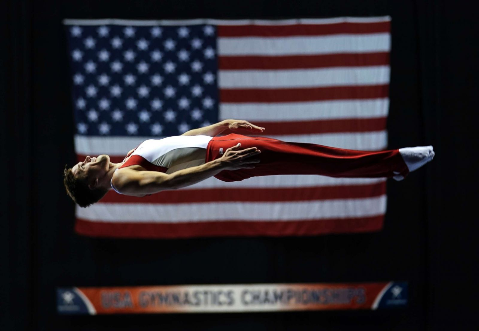 Image result for Logan Dooley, a 30-year-old trampoline athlete, appears suspended in the air during the Milwaukee Gymnastics Championships, June 29, 2017, in Milwaukee.