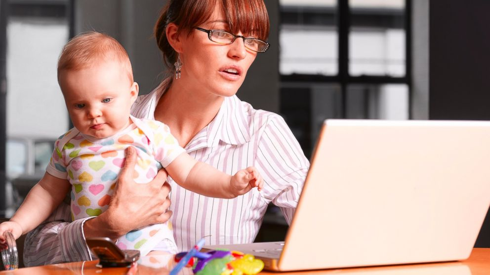 Gty Mother Holding Baby At Laptop Jt X
