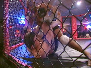 Pastor John Renken's team of ultimate fighters doesn't quite believe in turning the other cheek. (ABC News)