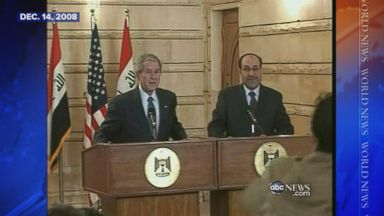 Dec. 14, 2008: Iraqi reporter throws his shoes at George W. Bush