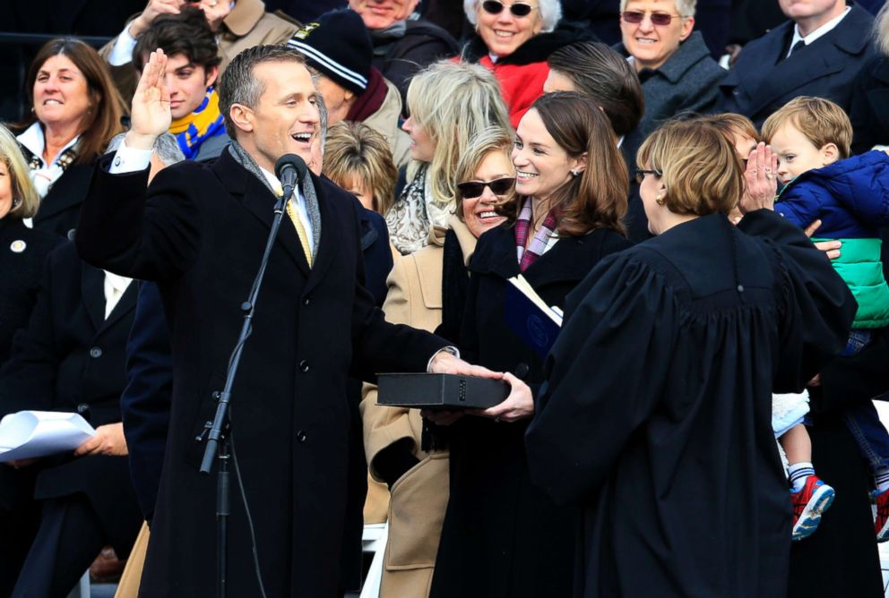 PHOTO: Missouri Gov. Eric Greitens takes the oath of office during a ceremony on the steps of the capitol in Jefferson City, Mo., Monday, Jan. 9, 2017. Looking on is his wife, Sheena.
