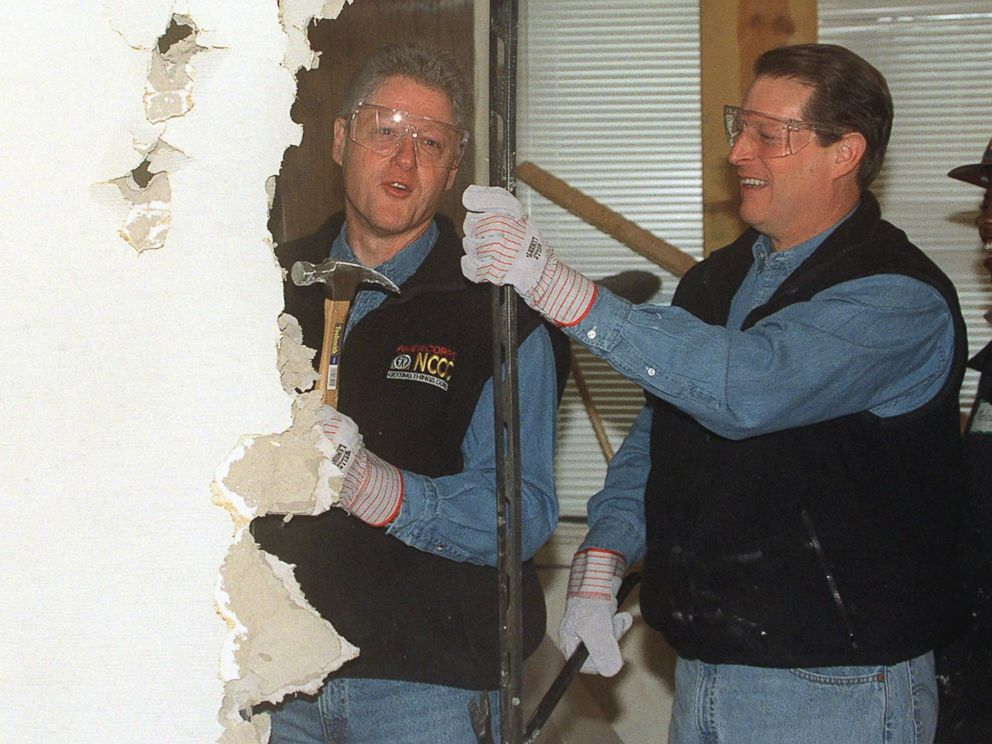 PHOTO: President Bill Clinton, Vice President Al Gore tear down a wall to begin renovation of the Regency House, a senior health center, Jan. 18, 1999 in Washington.