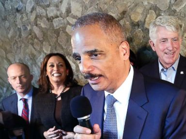 PHOTO: Former Attorney General Eric Holder, center, speaks during a get-out-the-vote event at Blue Bee Cider in Richmond, Va., Oct. 29, 2017.