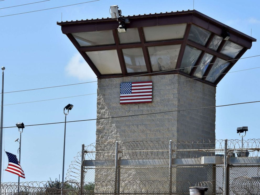 PHOTO: This file photo made during an escorted visit and reviewed by the U.S. military shows the razor wire-topped fence and the watch tower of Camp 6 detention facility at the US Naval Station in Guantanamo Bay, Cuba, April 8, 2014.
