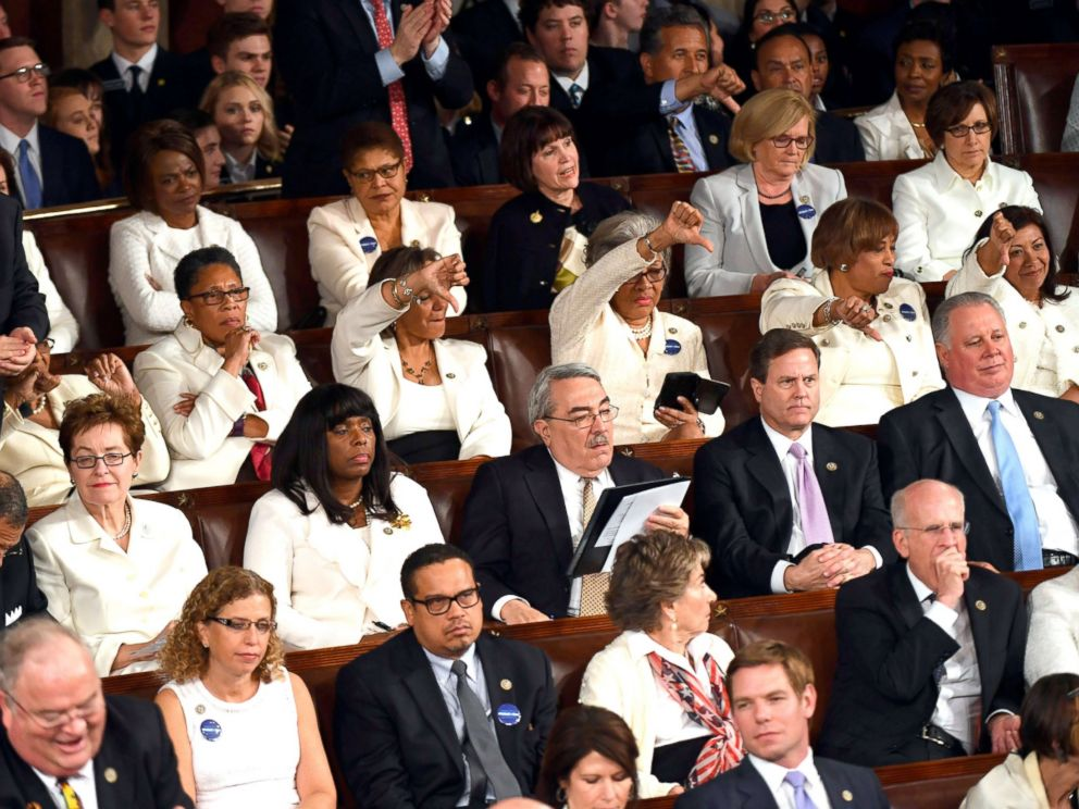 PHOTO: Members of Congress react as President Donald Trump addresses a joint session of Congress on Feb 28, 2017 in Washington, DC.