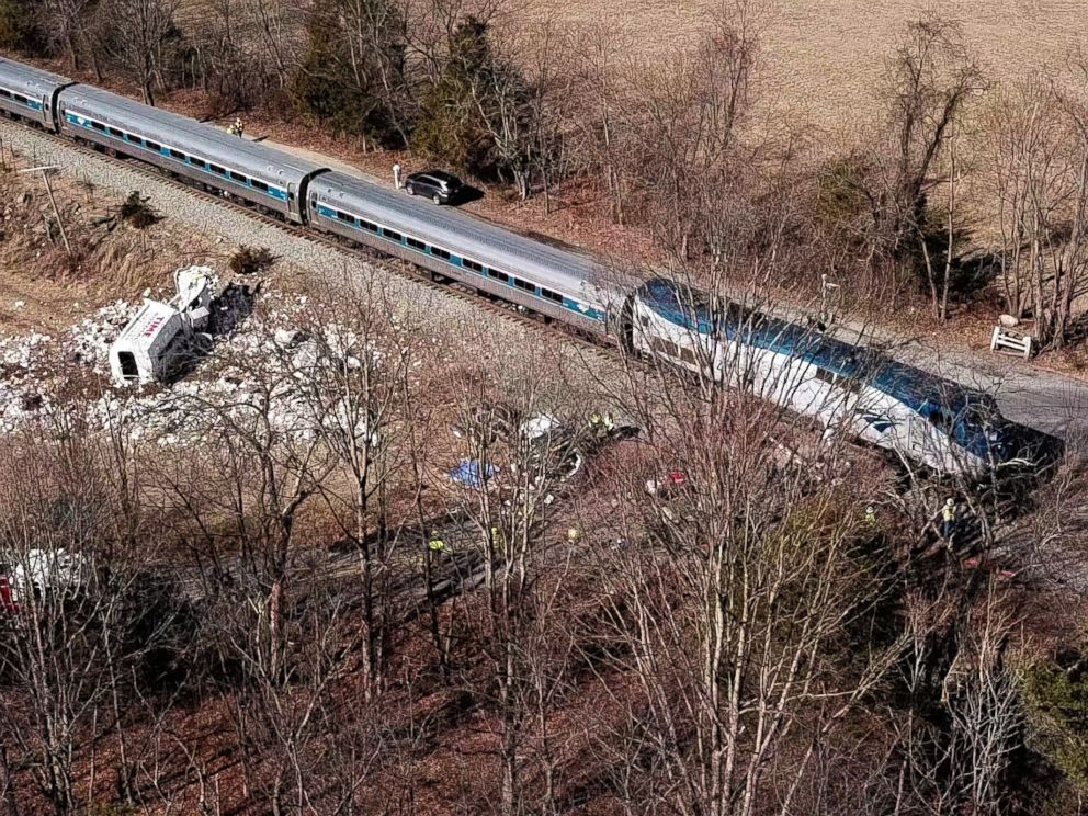 PHOTO: The wreckage of a garbage truck lies beside an Amtrak passenger train after a collision in Crozet, Va., Jan. 31, 2018.