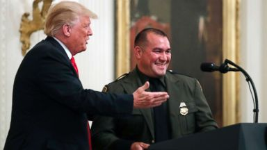 Trump calls on Hispanic-American immigration officer to speak, saying he 'speaks perfect English'