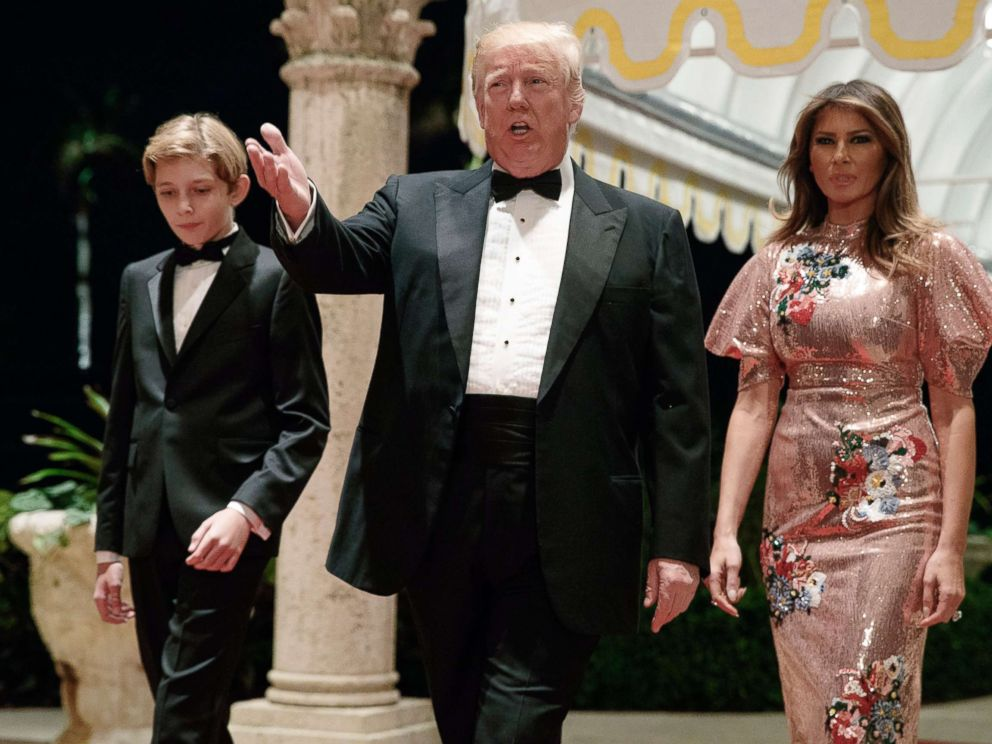 PHOTO: President Donald Trump, first Mrs. Melania Trump and her son Barron arrive at a New Year's Eve gala at their resort Mar-a-Lago , on December 31, 2017, in Palm Beach, Florida.