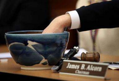 PHOTO: Strips of paper are removed from a bowl to decide a tied race between the two candidates during a meeting of the Virginia State Board of Elections on January 4, 2018 in Richmond, Virginia.