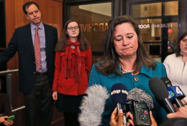 PHOTO: Democratic candidate Shelly Simonds talks to the press when her husband, Paul Danehy, left, and his daughter, Georgia Danehy, listen after a drawing to determine the winner of an election tied at the Capitol in Richmond , Goes. January 4, 2018.