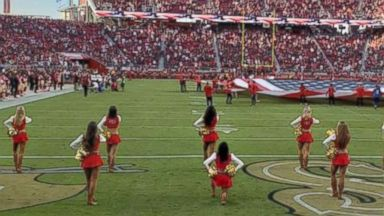 49ers cheerleader takes a knee during national anthem at Raiders game