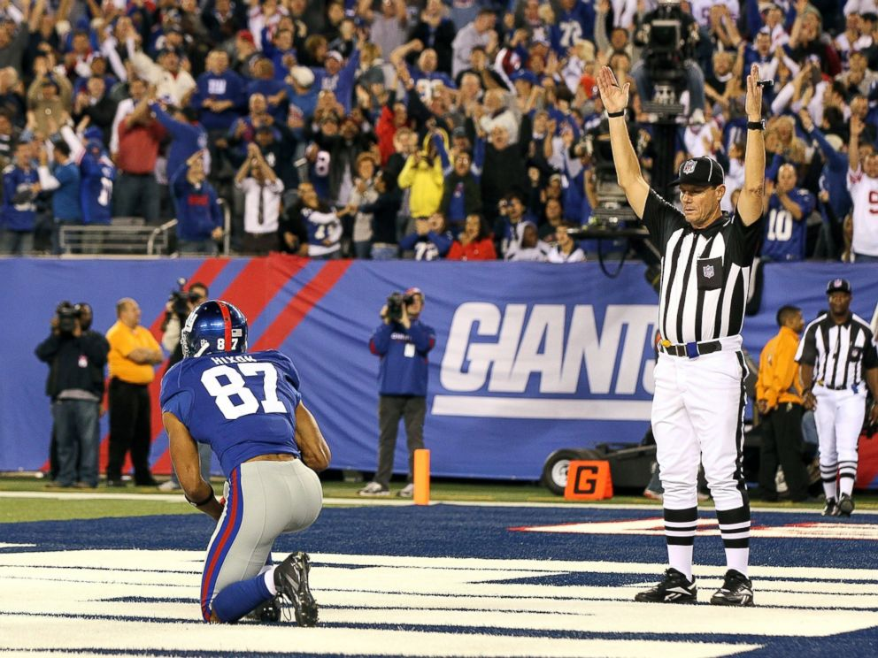 PHOTO: Domenik Hixon #87 of the New York Giants kneels in the endzone after his touchdown against the St. Louis Rams, Sept. 19, 2011, at MetLife Stadium in East Rutherford, N.J. The Giants defeated the Rams 28-16.
