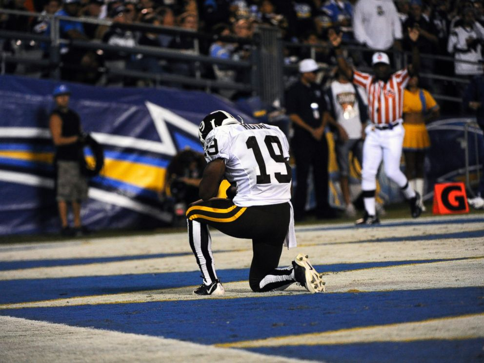 PHOTO: The Denver Broncos Eddie Royal kneels in the end zone after scoring his 2nd runback for a touchdown vs. the San Diego Chargers at Qualcomm Stadium in San Diego, Oct. 19, 2009.