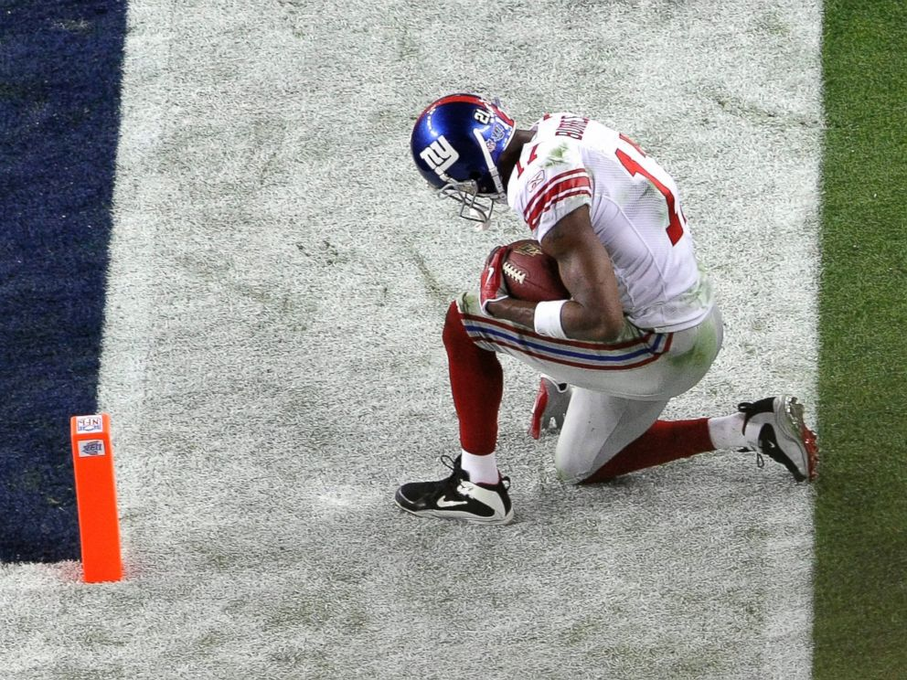 PHOTO: Plaxico Burress #17 of the New York Giants kneels just outside the end zone after he scored on a touchdown reception against the New England Patriots during Super Bowl XLII, Feb. 3, 2008, at the University of Phoenix Stadium in Glendale, Ariz.