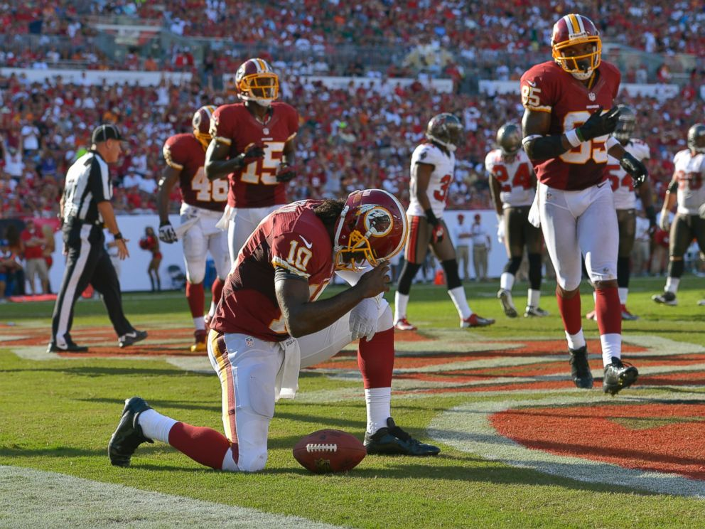 PHOTO: Washington Redskins quarterback Robert Griffin III (10) kneels down after scoring a rushing touchdown against Tampa Bay in the second quarter of Washingtons 24-22 win at Raymond James Stadium, Sept. 30, 2012, in Tampa Bay, Fla.