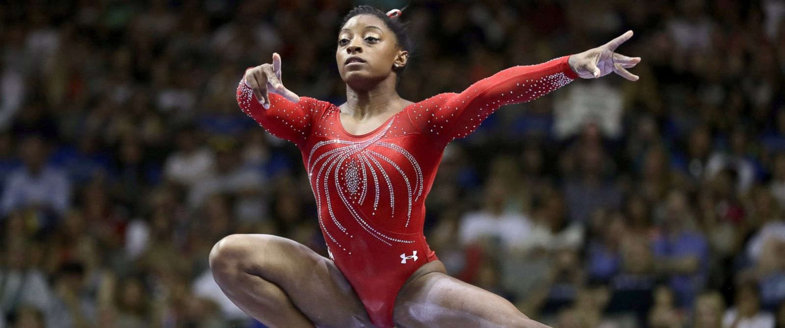 how tall is olympic biles