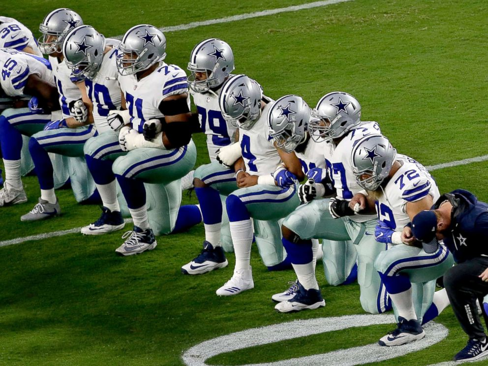 PHOTO: The Dallas Cowboys take a knee prior to the national anthem prior to an NFL football game against the Arizona Cardinals, Sept. 25, 2017, in Glendale, Ariz.