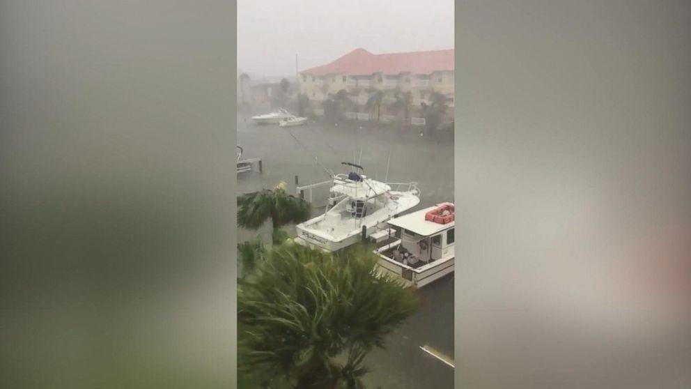 e55e8d55163 ... Heavy rain, wind rock boats during Hurricane Harvey Video