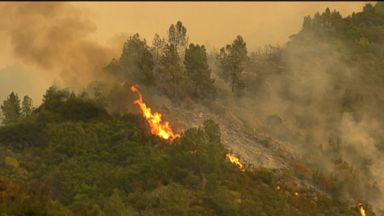 Firefighters struggle to contain deadly, rapidly growing wildfire