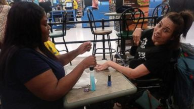 Cashier steps in to give wheelchair-bound woman a manicure