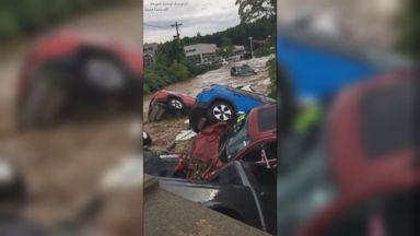 Flash floods wash cars off dealership
