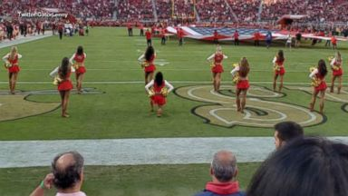 Cheerleader takes a knee during national anthem