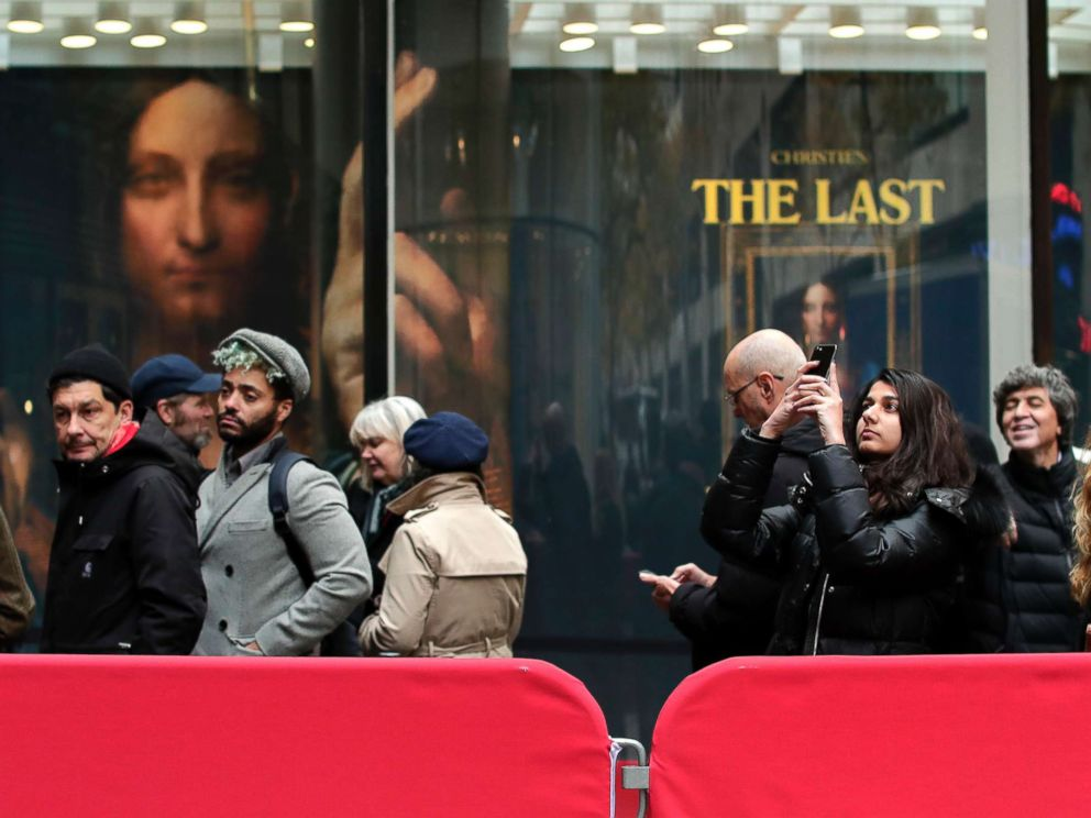 PHOTO: Visitors wait outside Christies to view Leonardo da Vincis Salvator Mundi, Nov. 14, 2017, in New York. The painting is expected to sell at auction for $100 million on Wednesday.