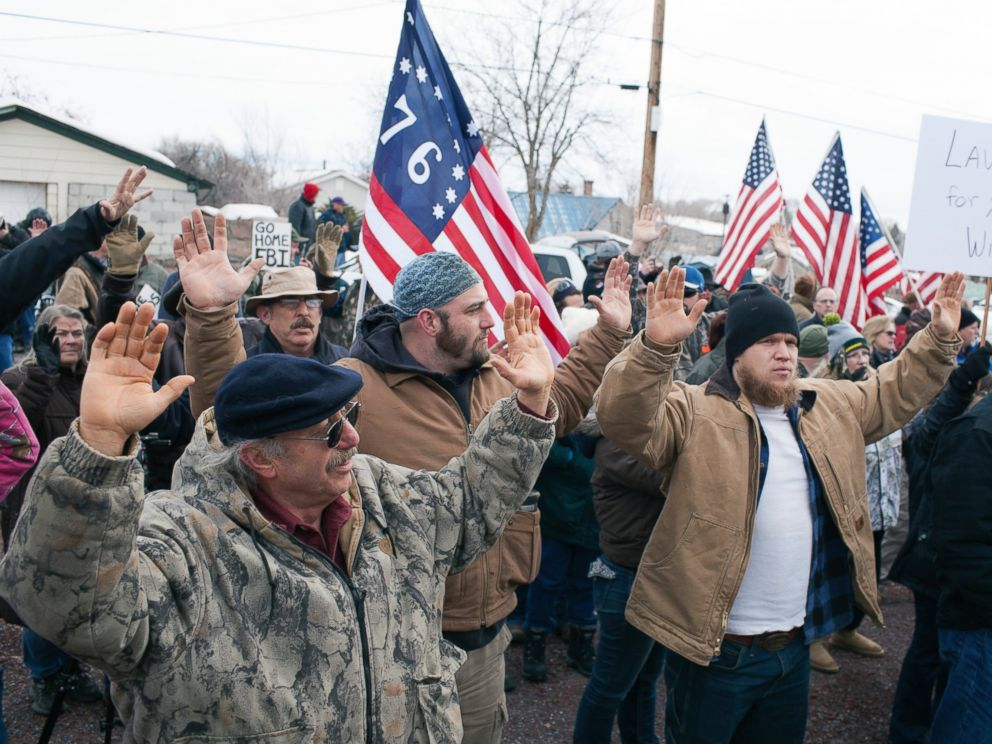 PHOTO: Anti-government protesters raise their arms in the air and shout hands up dont shoot outside the Harney County Courthouse on Feb. 1, 2016 in Burns, Oregon.