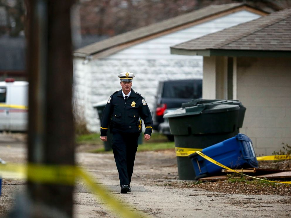 PHOTO: A police officer walks through the alley near 6th Avenue and Cortland Avenue in Columbus, Ohio where the body of missing Ohio State football player, Kosta Karageorge was discovered in a dumpster on Nov. 30, 2014.