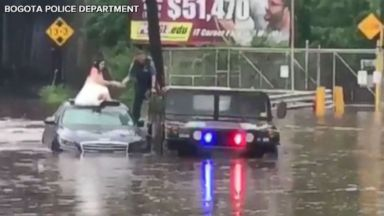Police officer rescues bride stranded in New Jersey floodwaters