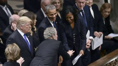 A blink-and-you'll-miss-it moment between George W. Bush and Michelle Obama at his dad's funeral
