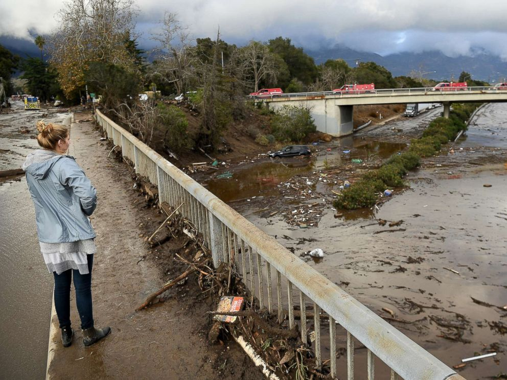 PHOTO: A woman looks at the 101 freeway from Olive Mill Road in Montecito, Calif., Jan. 9. 2018, after heavy rainfall brought mudslides and debris cascading down from hillsides denuded by recent wildfires.