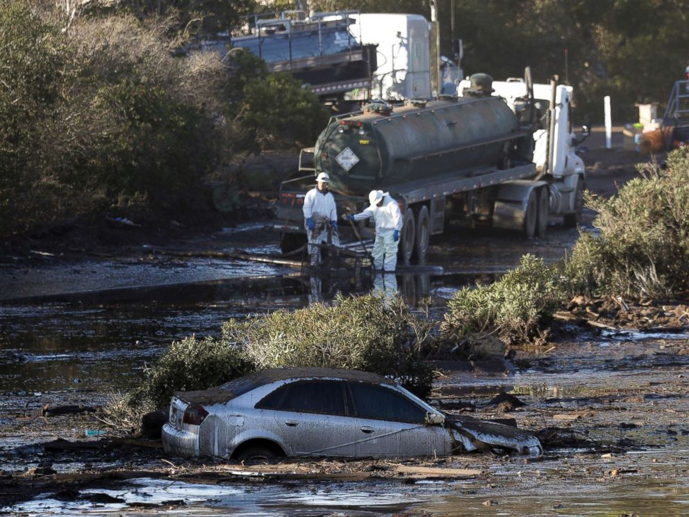 PHOTO: Crews pump mud on Highway 101 after an avalanche, January 13, 2018, in Montecito, California