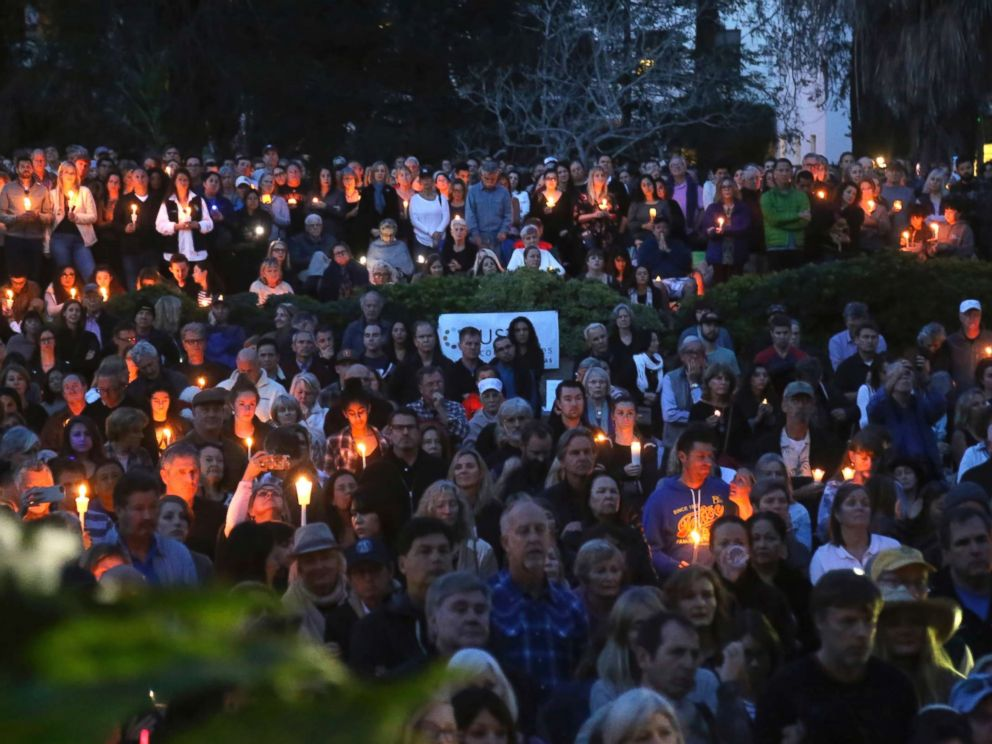 PHOTOGRAPHY: People attend a candlelight vigil in Santa Barbara, California, on January 14, 2018, to pay tribute to people who died when landslides swept through southern California.