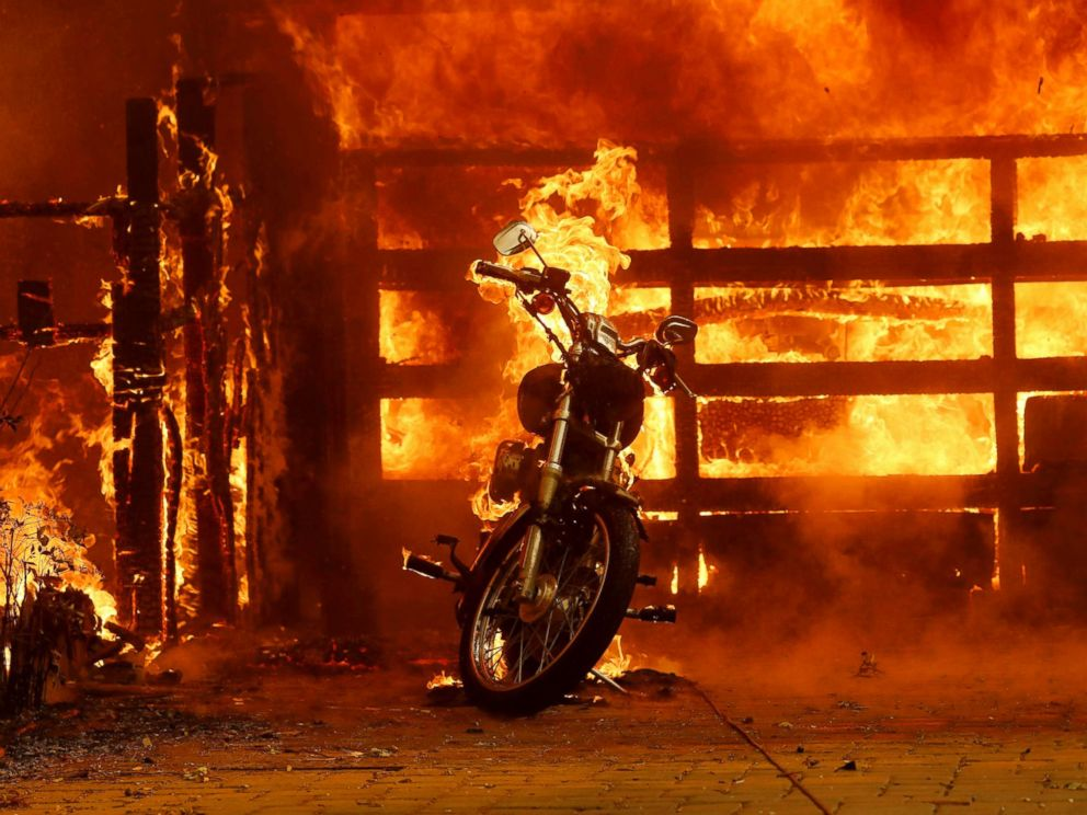 PHOTO: A motorcycle burns in the driveway of a home on fire in Glen Ellen, Calif., Oct. 9, 2017.
