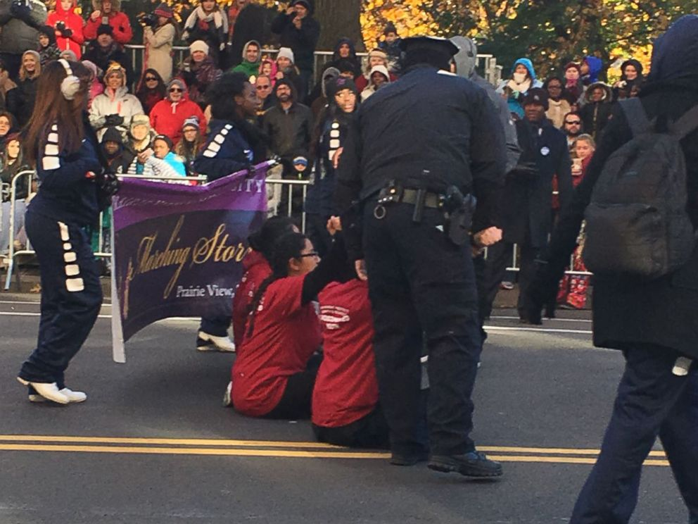 PHOTO: The protesters sat in the middle of Central Park West at 70th Street and momentarily delayed the parade before they were carried off by NYPD police officers.