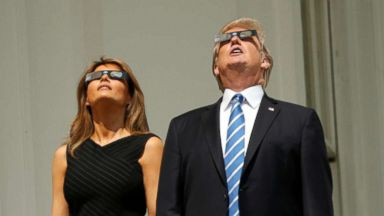 President and Melania Trump watch total solar eclipse from White House balcony
