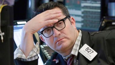 US markets erase earlier losses