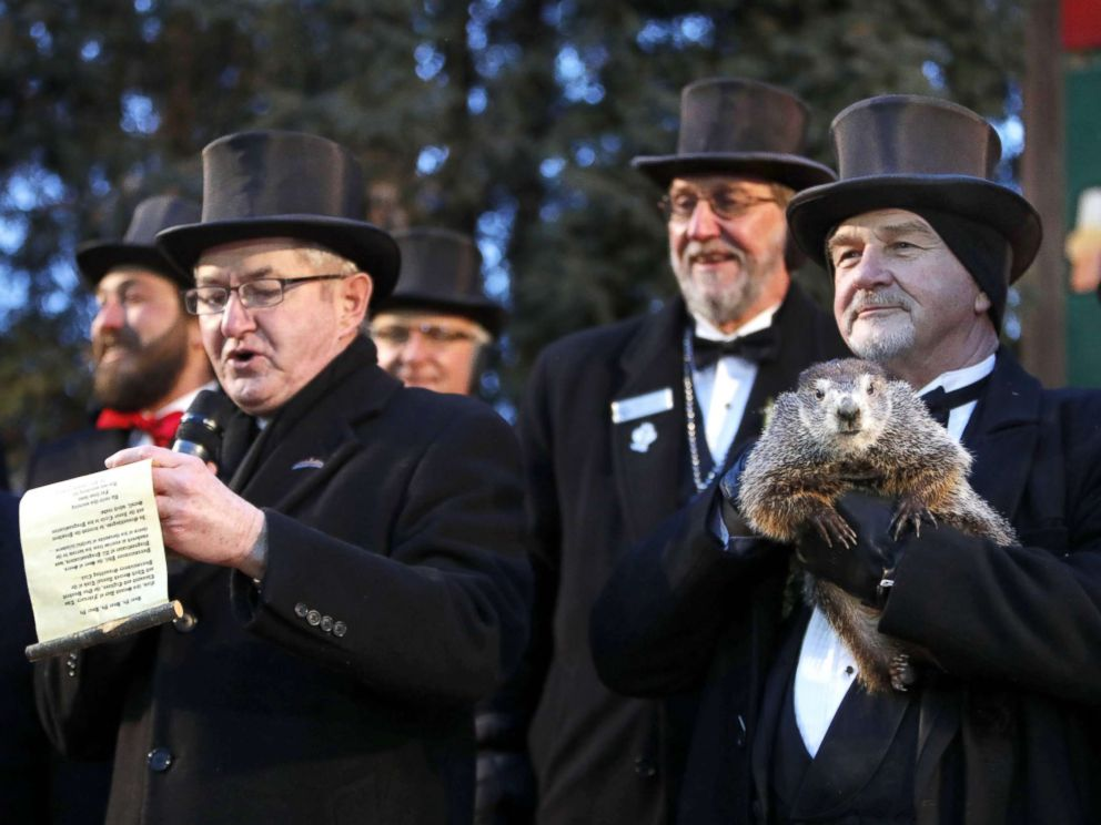 PHOTO: Groundhog Club co-handler John Grifiths (R) holds Punsxutawney Phil the weather prognosticating groundhog as groundhog club vice president Jeff Lundy (L) reads his prediction during the Groundhog Day in Punxsutawney, Penn., Feb 2, 2018.